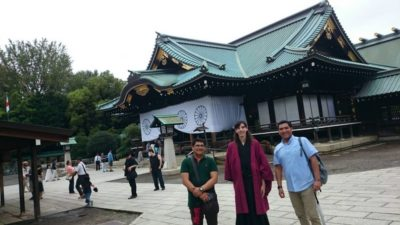 Tour customers in front of the controversial Yasukuni Shrine main hall in Tokyo, Japan