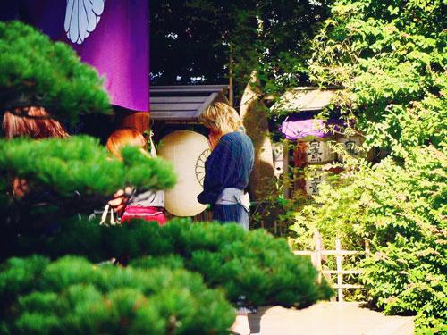 Man praying at the Tokyo Daijingu Love Shrine in Japan