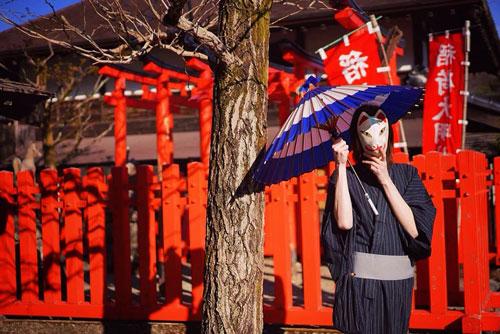 Man in kimono with a parasol in Edo Wonderland in Nikko, Japan
