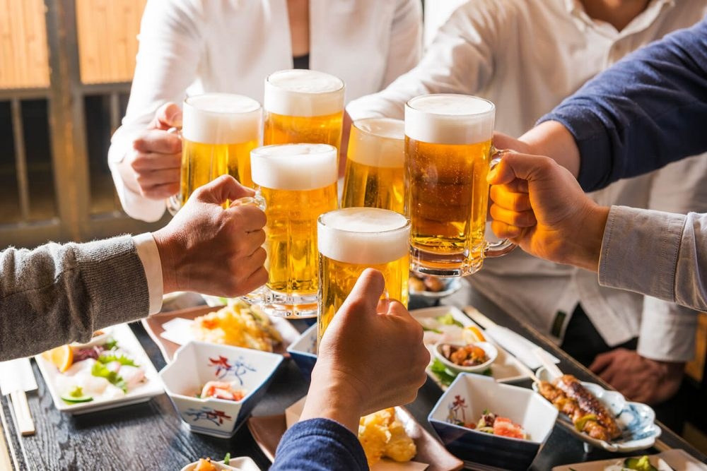 Japanese men toasting with beer