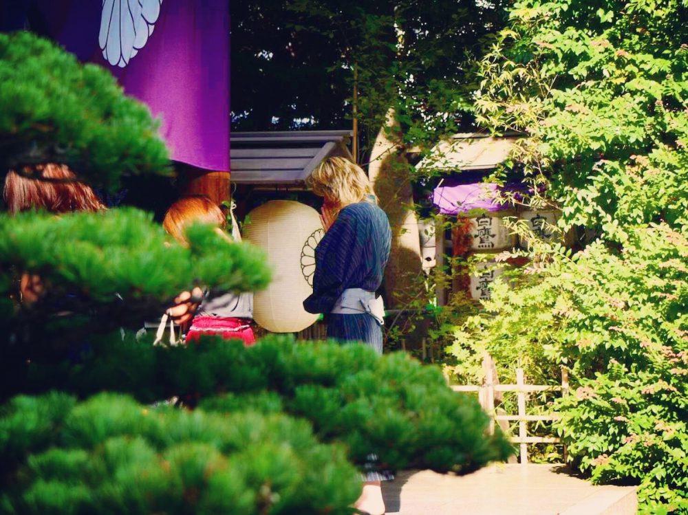 Man praying at a Shinto shrine in Japan