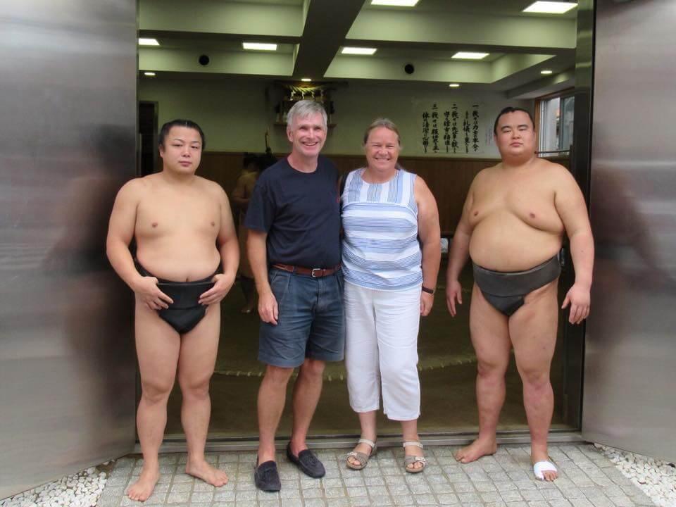 Sumo wrestlers posing with a tourist in Ryogoku, Tokyo, Japan