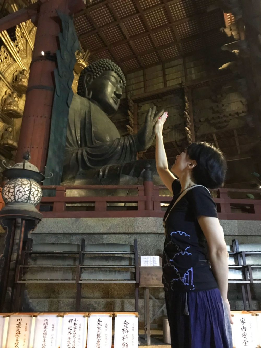 Child visiting Todaiji Temple, one of Japan's most important Buddhist temples