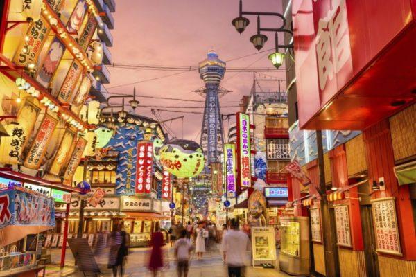 Shinsekai area by night in Osaka, Japan