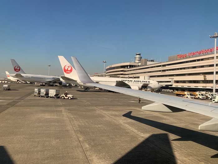 Airplane waiting at Haneda Airport in Tokyo, Japan