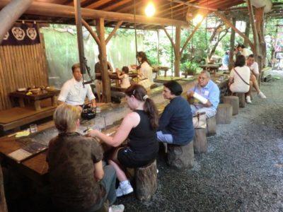 Tourists enjoying a tea workshop during a Japan tour