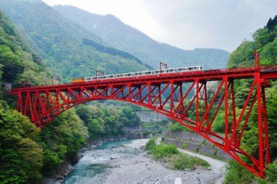Red bridge over the Kurobe Gorge in Toyama, Japan