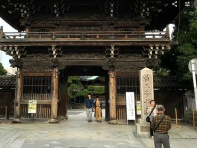 Japanese tourists taking pictures in front of Shibamata temple