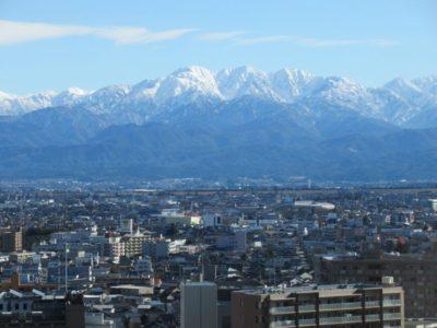 Toyama City with Tateyama Mountain Range