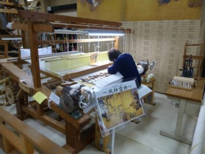 Artisan working in Nishijin Textile Center in Kyoto
