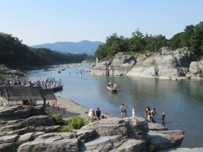 People playing in the river in Nagatoro, Japan