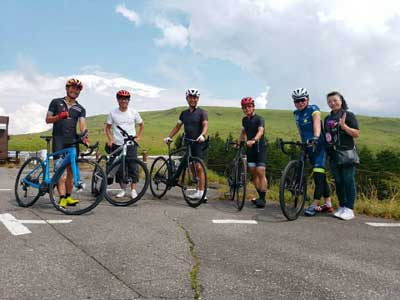 Cycling tour participants with bicycle near Mt Fuji