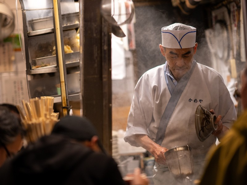 Chef cooking street food in Japan